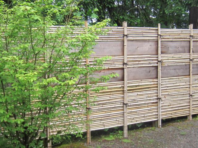 Here the upper portions of the bamboo screen is broken up by wooden planks.
